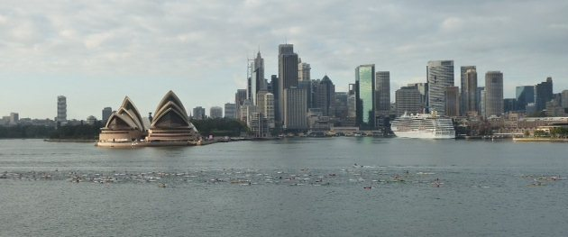 The spectacular skyline of Sydney as the paddlers race towards Manly