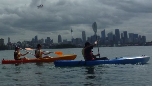 Kayaks, the Sydney skyline, and a landing sea-plane!
