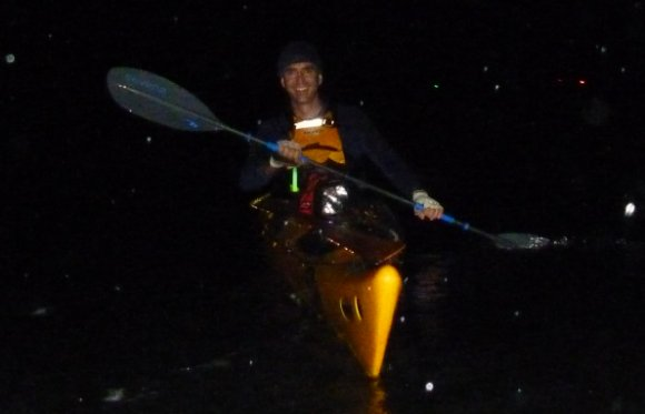 Ned paddling through the rain