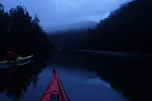 First light. Glassy water, layers of fog, and complete silence.