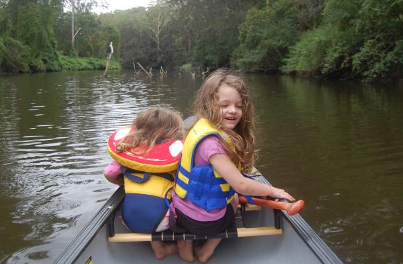 Kids in a canoe in the Great Outdoors - how could they not have fun?