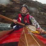 Important rules when paddling near cliffs - always wear a helmet... and an ugly shirt.