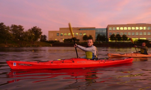 Paddlers setting off at sunset for a night cruise through Chi-Town