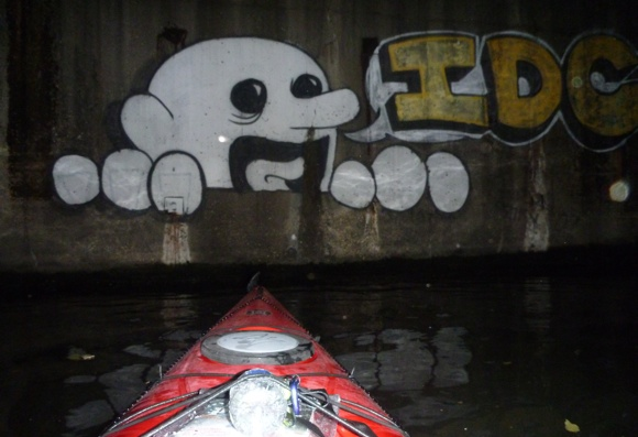 Larger than life graffiti on the concrete banks of the river. It was twice as high as I was.