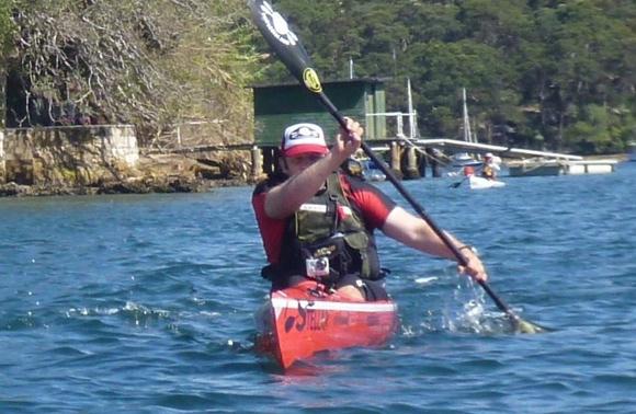 Some flat bloke splashing about, pretending to look like he was paddling fast